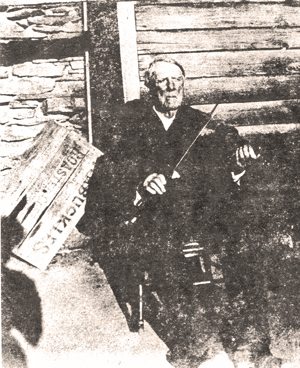 George Abner Power with his fiddle, behind his house in Land Lot 217 (Power Family Collection).