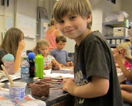 Student at a Baltimore Clayworks summer camp