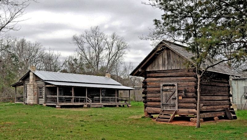 On the right is the Turner Corn Crib and on the left is the Matthews Cabin