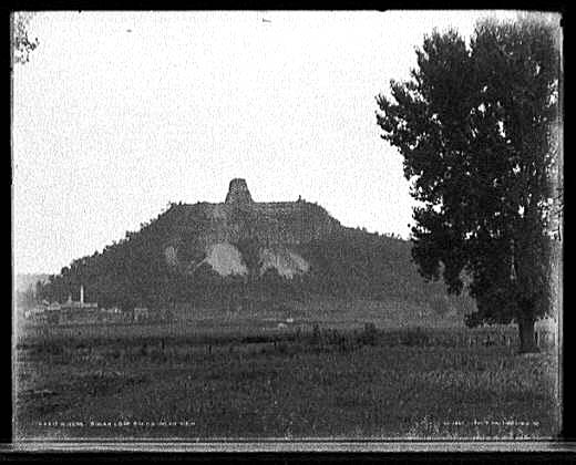 A historic photo of Sugar Loaf in 1898 shows the effect of quarrying operations in giving the bluff its square appearance.