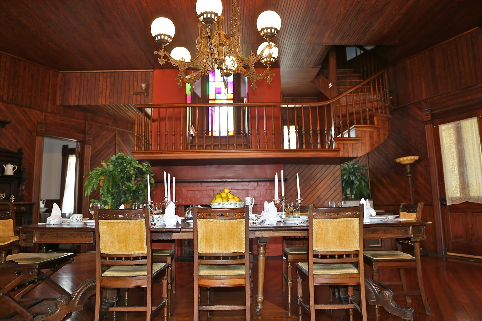 View of the dining room and the double flue chimney, with the staircase running between them