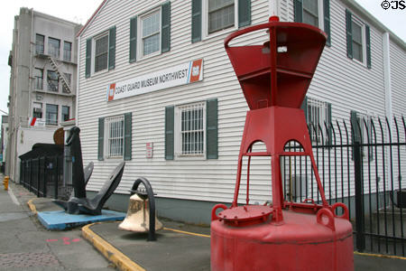 Exterior of the Coast Guard Museum with buoy in the foreground.