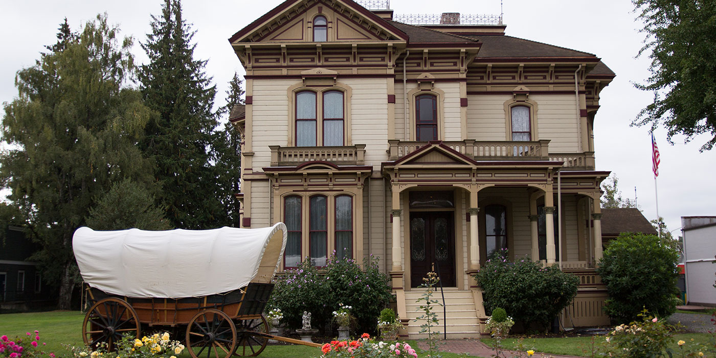 The Meeker Mansion with a very appropriate covered wagon in the foreground.