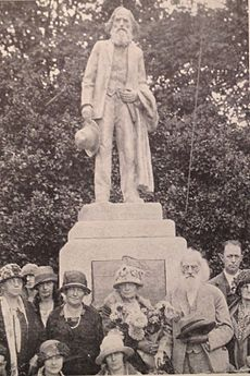 Ezra Meeker (lower right) at the dedication of his statue located at the location of his former log cabin home.