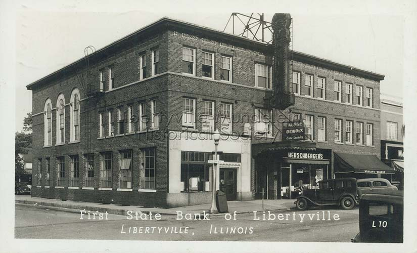 First State Bank of Libertyville with La Villa Theater sign, circa 1948
