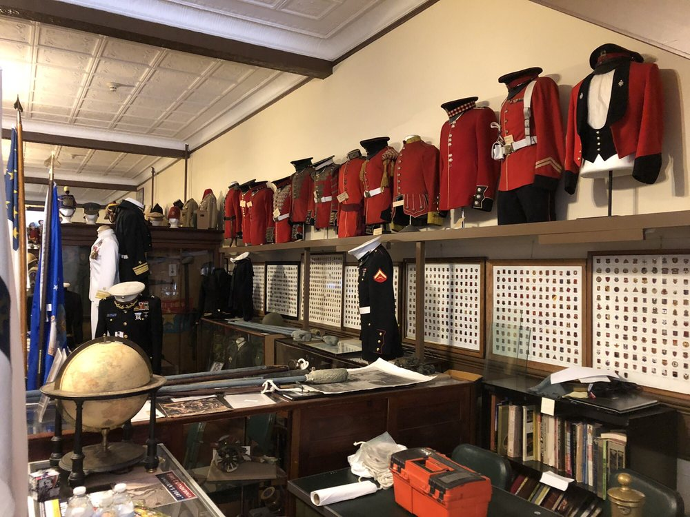 Various military uniforms and other artifacts in the museum's storage space.