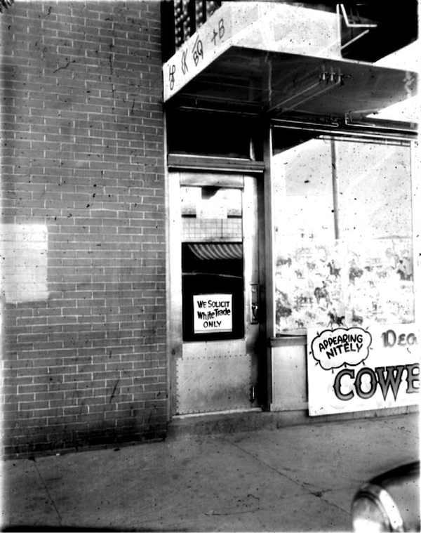 "In 1954, the owner of the Cowboy Bar, located at the corner of South First and East Center, placed this ""white trade only"" sign on his window. Signs like this were rare in Pocatello, although more subtle forms of discrimination were common."
