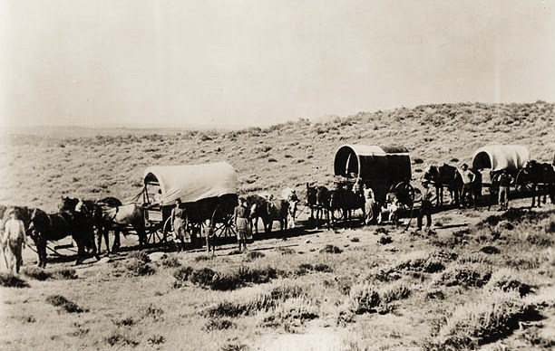 Wagon train of emigrants on the Oregon Trail