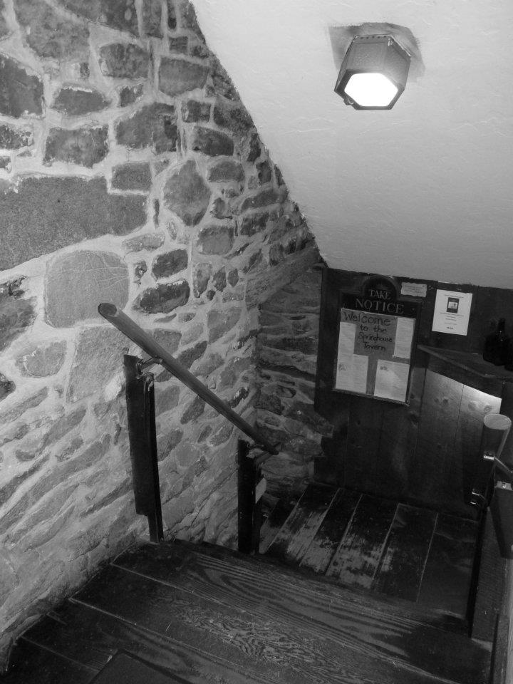 Original Colonial staircase leading to basement Tavern.
