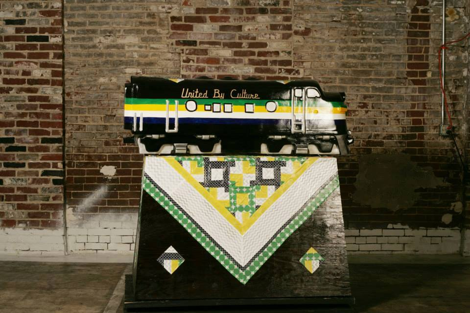 """""""United by Culture"""" was designed by Karen Frye who wanted to portray Appalachian identity through its relationship to quilting while including Marshall University and West Virginia University colors to depict the in-state university rivalry. (Photo c"""