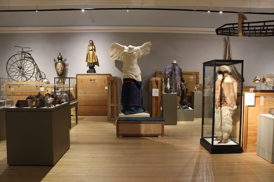 Various artifacts on display in the museum; Mathew Henson's fur body suit is on the left.