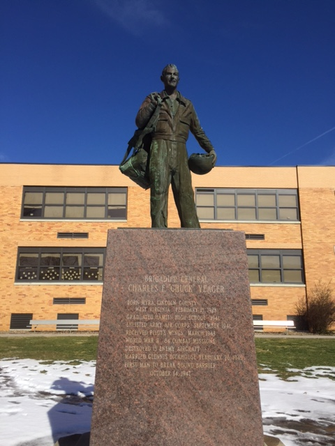 The front of the statue which highlights important dates/events in Yeager's life.
