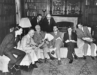 In the Study at Dumbarton Oaks. Seated (left to right): Peter Loxley; Sir Alexander Cadogan; Edward R. Stettinius, Jr.; Andrei A. Gromyko; Arkadii A. Sobolev; Valentin M. Berezhkov. Standing (left to right): James Clement Dunn and Leo Pavlovsky