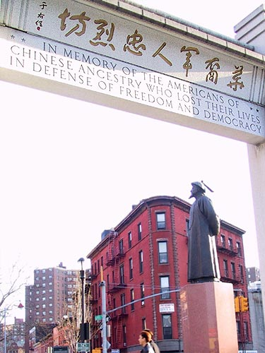 Lin Zexu memorial statue in background, with nearby Americans of Chinese Ancestry memorial arch in foreground (image from http://www.nychinatown.org/chatham.html).