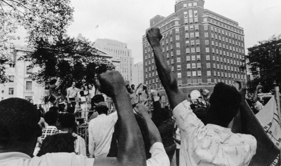 "At a vigil on the New Haven Green Tuesday, Aug. 26, 1970 supporters raise their fists chant ""Free Lonnie Mclucas"". (AP Photo)"