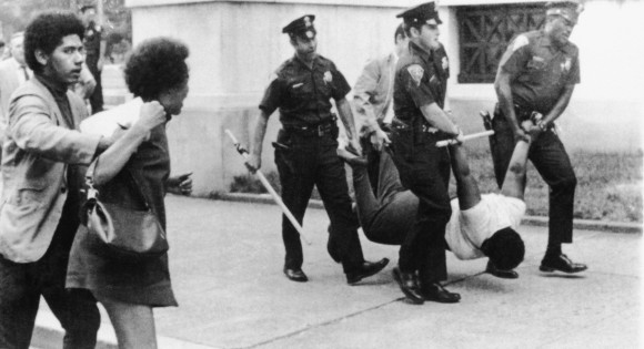 Police drag and carry New Haven Panther Edith Jackson, 18, off to courthouse after charging her with breach of peace and abusing a policeman during a rally supporting Panther defendant Lonnie McLucas Sunday, Aug. 30, 1970 in New Haven, Connecticut. (