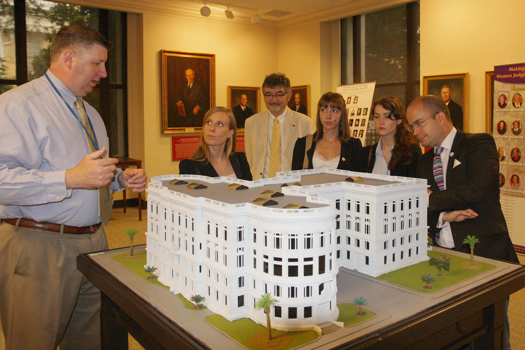 French students tour the Supreme Court Building which included the viewing of a model of the Supreme Court Building.