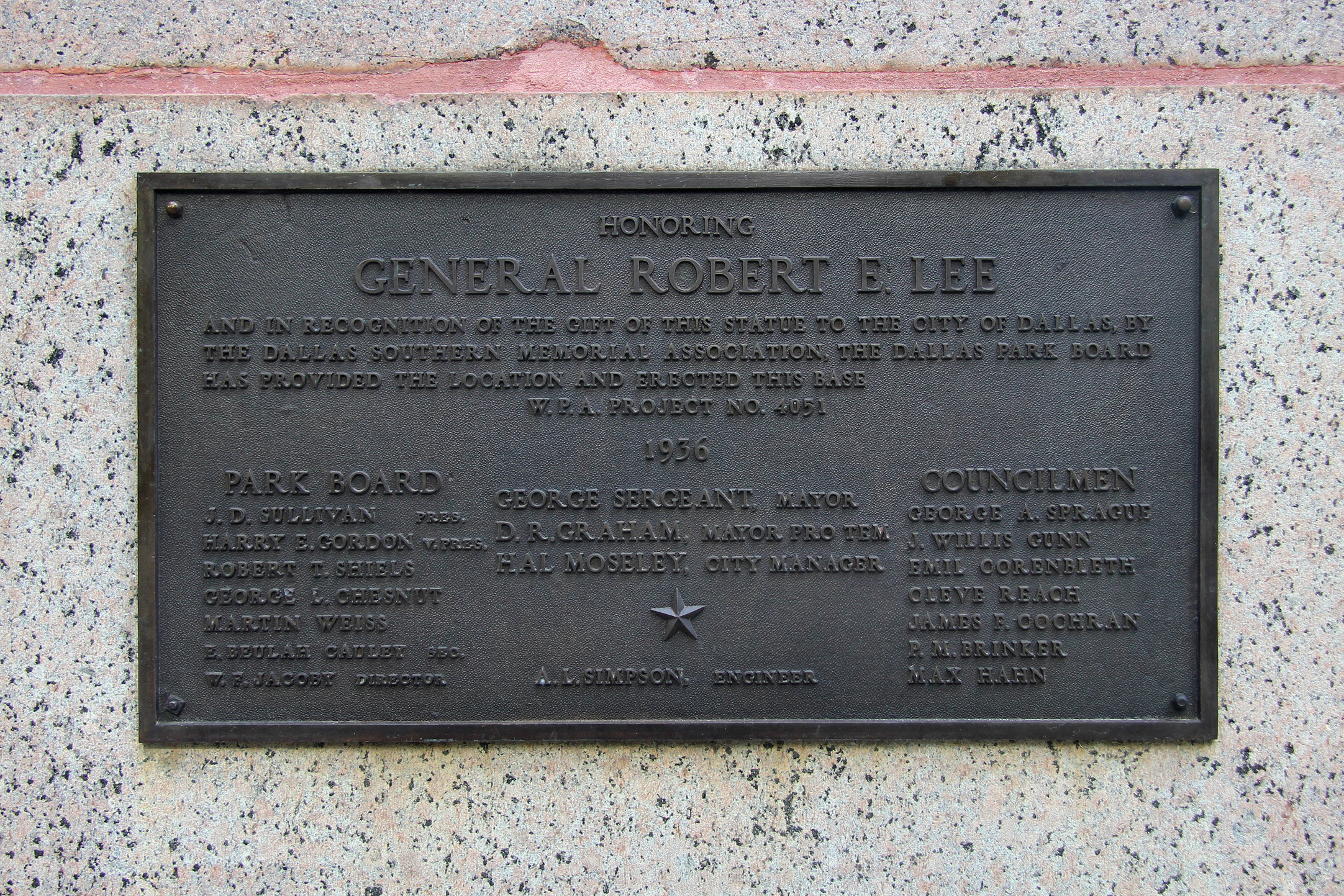 The dedication plaque on the statue's base.