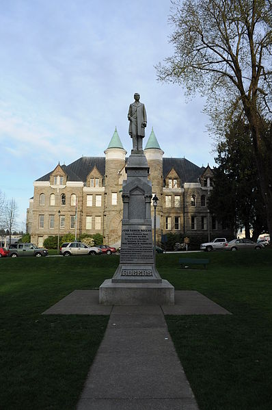 The statue is located next to the former state capitol within the center of Sylvester Park.
