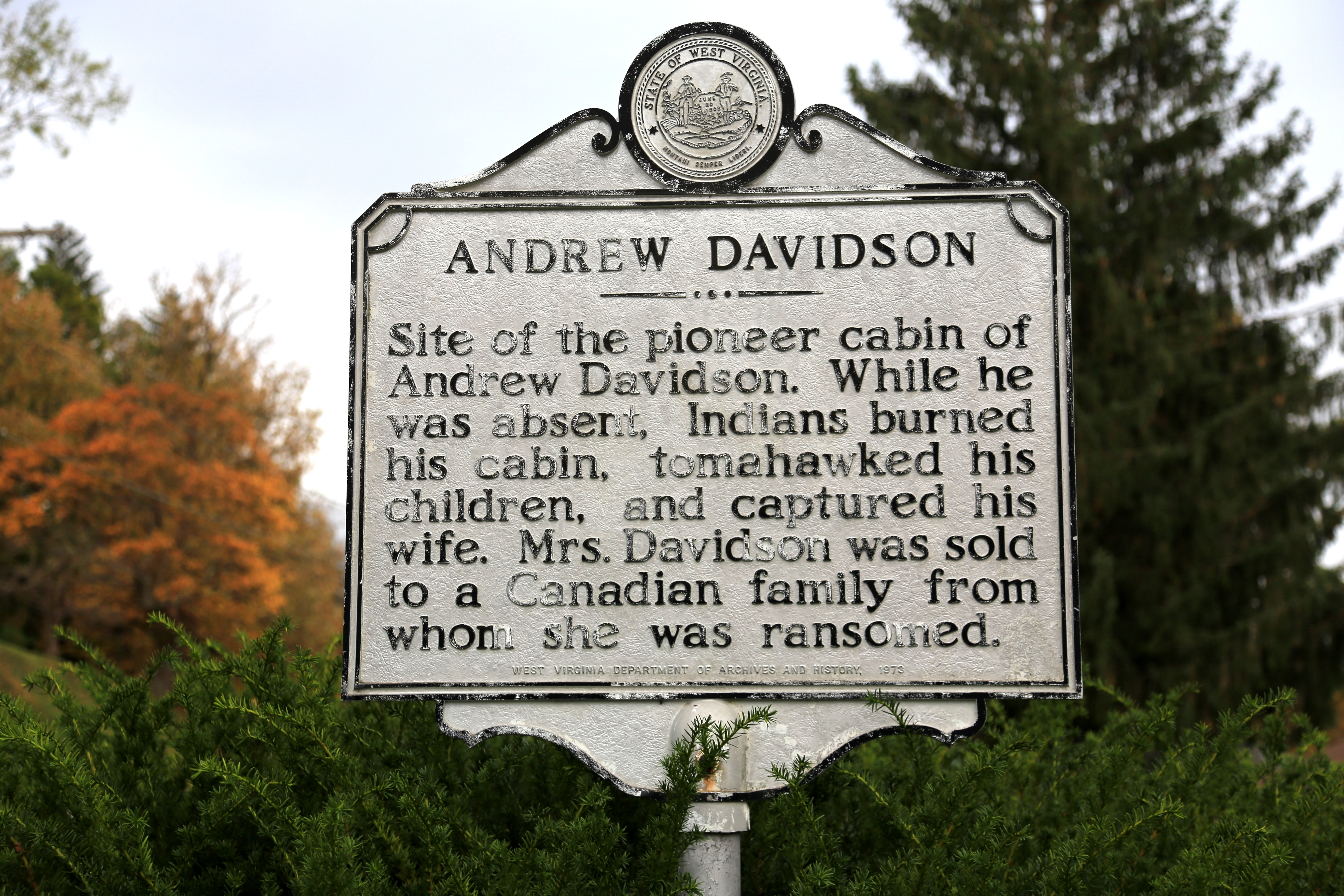 """Marker on the site of the Davidson Cabin. """"While he was absent, Indians burned his cabin, tomahawked his children, and captured his wife. Mrs. Davidson was sold to a Canadian family from whom she was ransomed."""""""