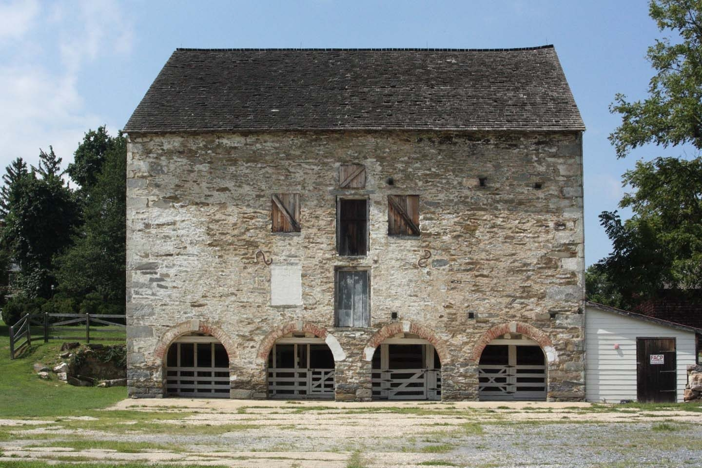 Woodlawn Manor's stone barn (image from Historic Markers Database)
