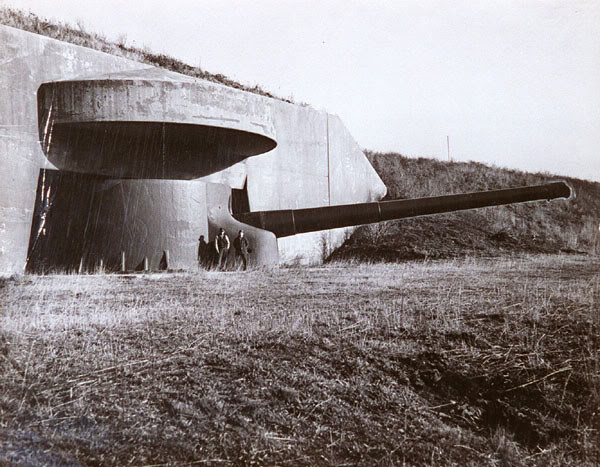 The base was used for coastal defense throughout the 20th century. This historic photo shows a 16-inch gun and a fortified casemate.