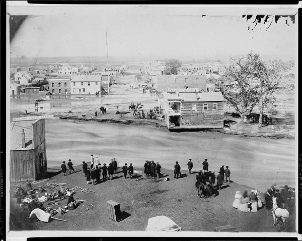 People stand on the banks of Cherry Creek during Denver's Great Flood on May 19, 1864. (From the Library of Congress Digital Archives)