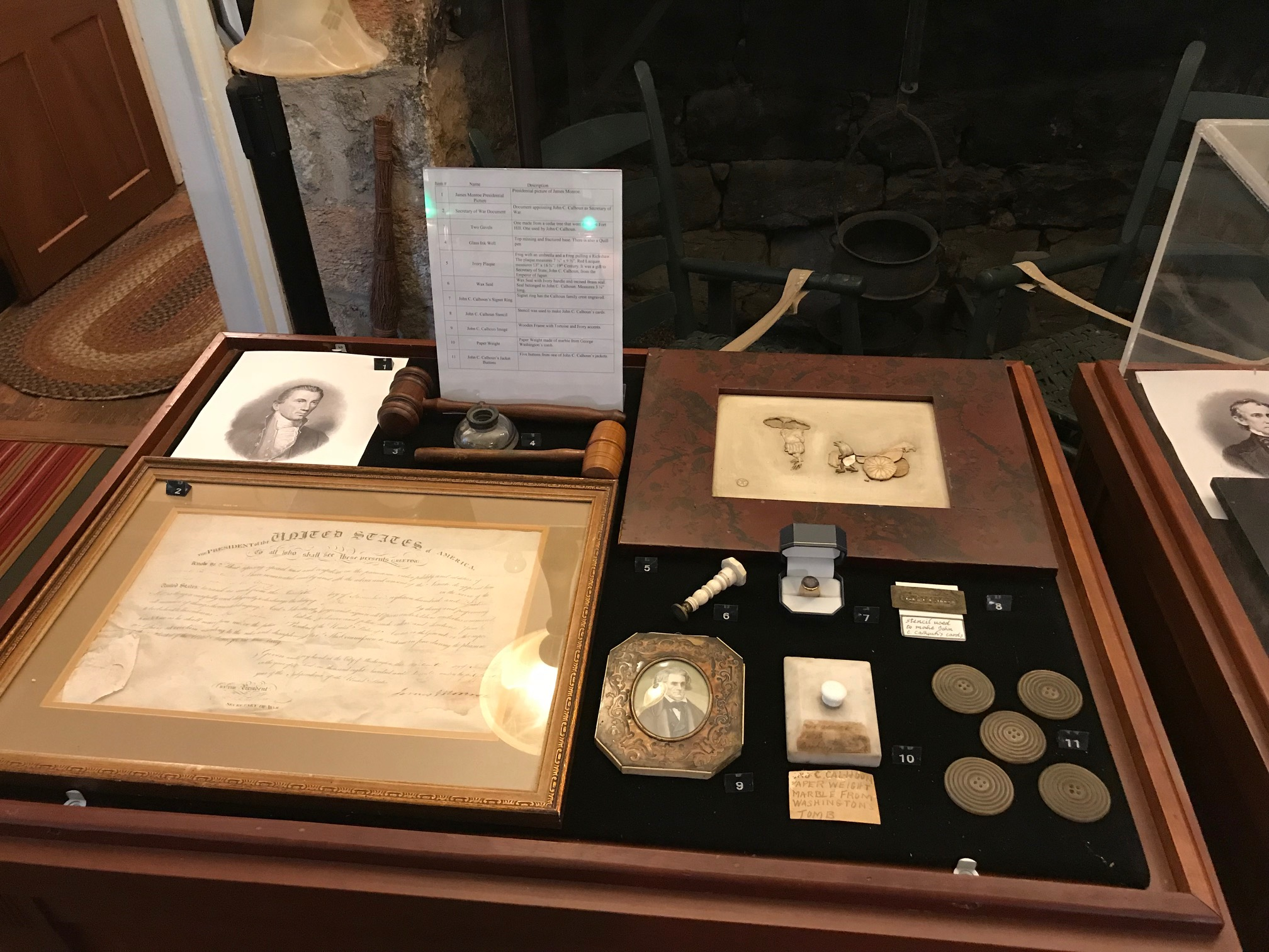 Display Case containing small personal items pertaining to the people of Fort Hill