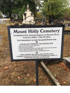 Signage with information regarding regulations of the cemetery and contact information for the sexton.Photo taken by Randall Crawford.