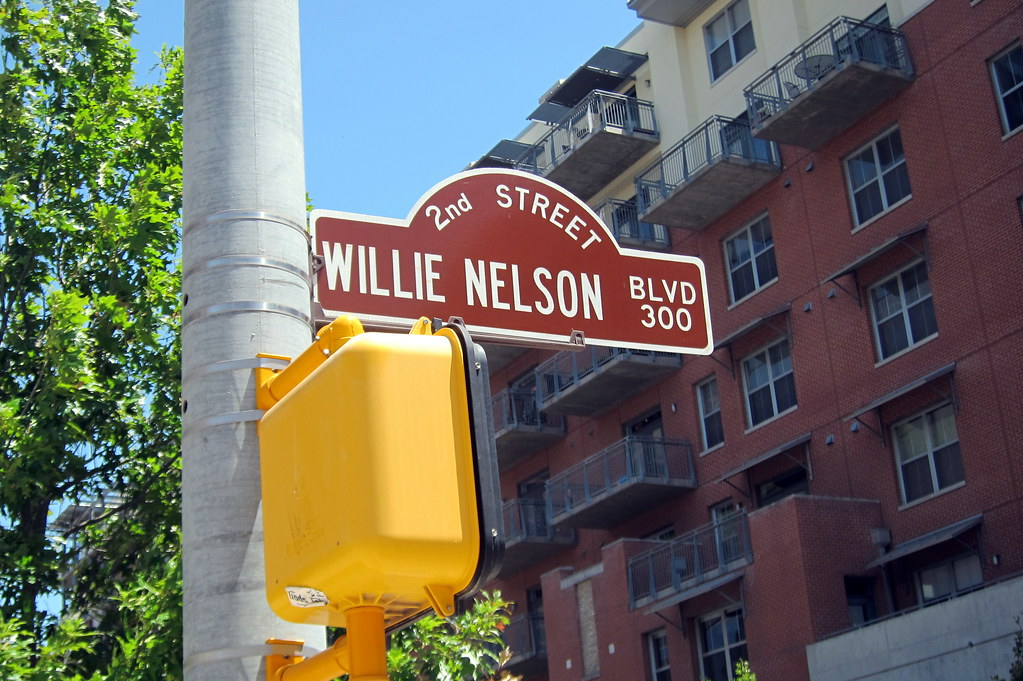 "The theater is located on a stretch of 2nd Street that the city renamed ""Willie Nelson Blvd"""