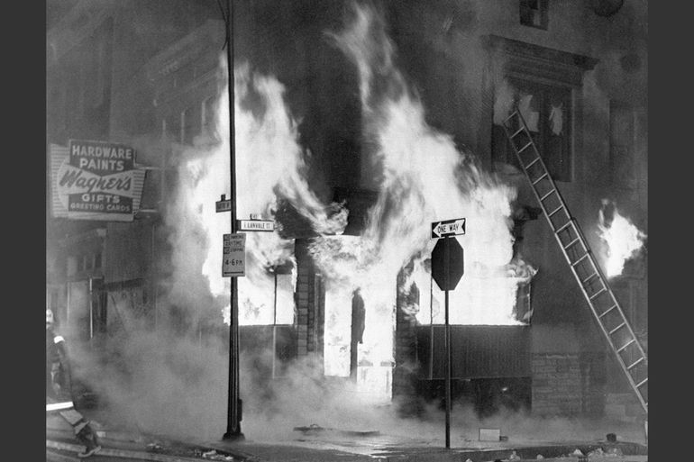 A fire engulfs a store in Baltimore on April 7, 1968. Photo by Bettmann/Corbis