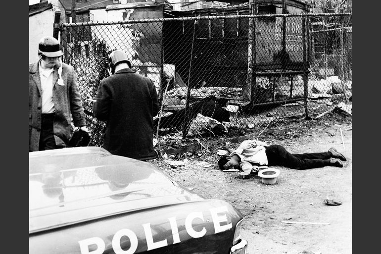 The body of James Harrison lies in an alleyway where a policeman shot him on April 8, 1968. Photo by Baltimore News-American/AP