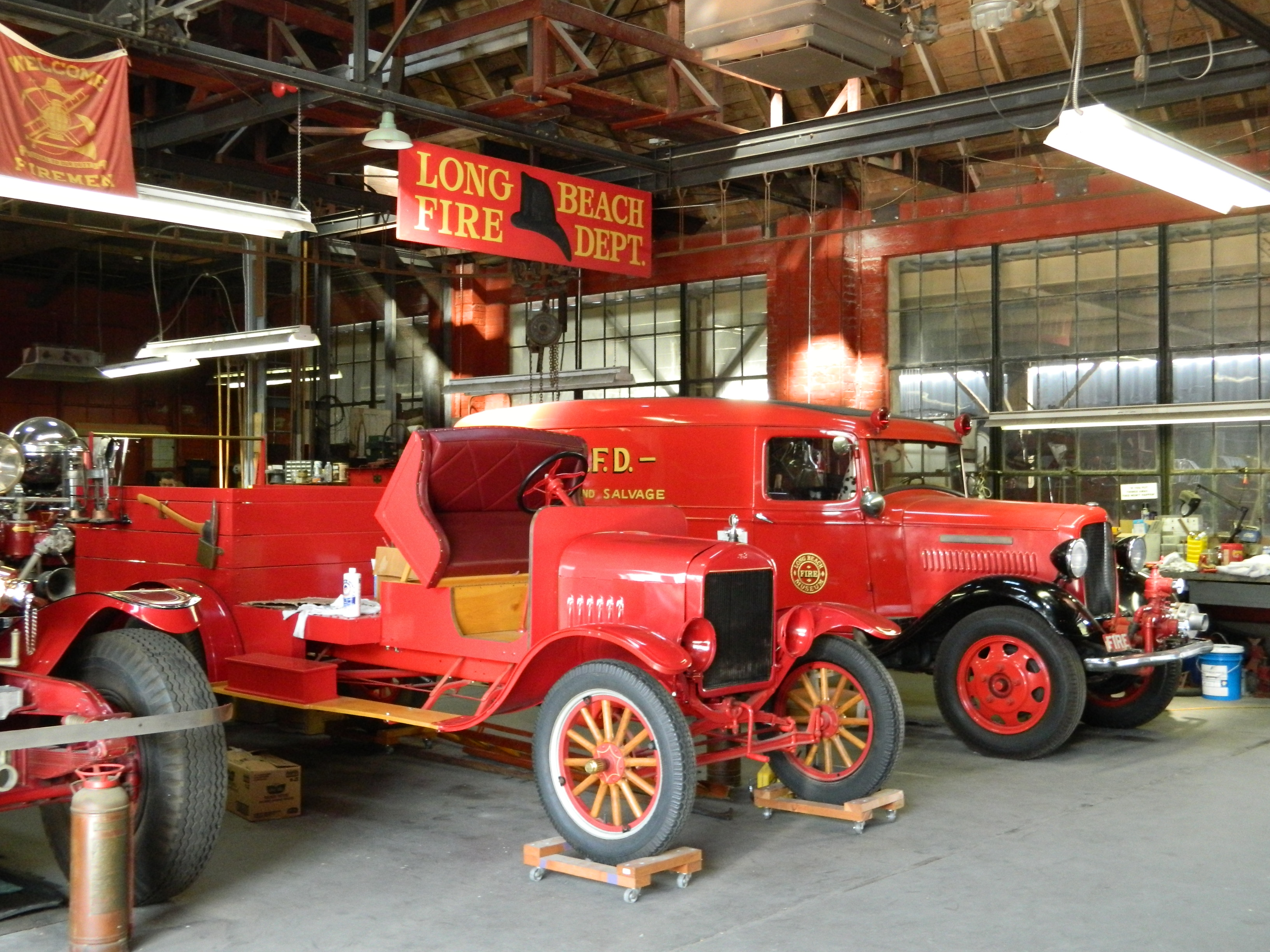 Fire fighting vehicles on display within the museum.