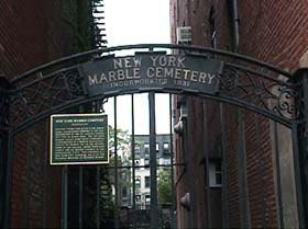 Entrance to the cemetery is via iron gates