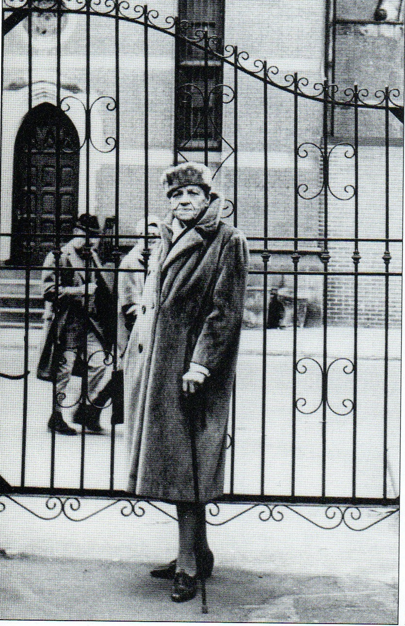 Djuna Barnes at the Patchin Place gate, photographed by Marion Morehouse in 1962 (image from Ephemeral New York)