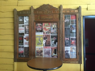 "One of the few remaining original features of the movie theatre is the wooden ""picture"" or ""poster"" frames. There are two of these in the entry hallway of the theatre, on both the left and right sides."