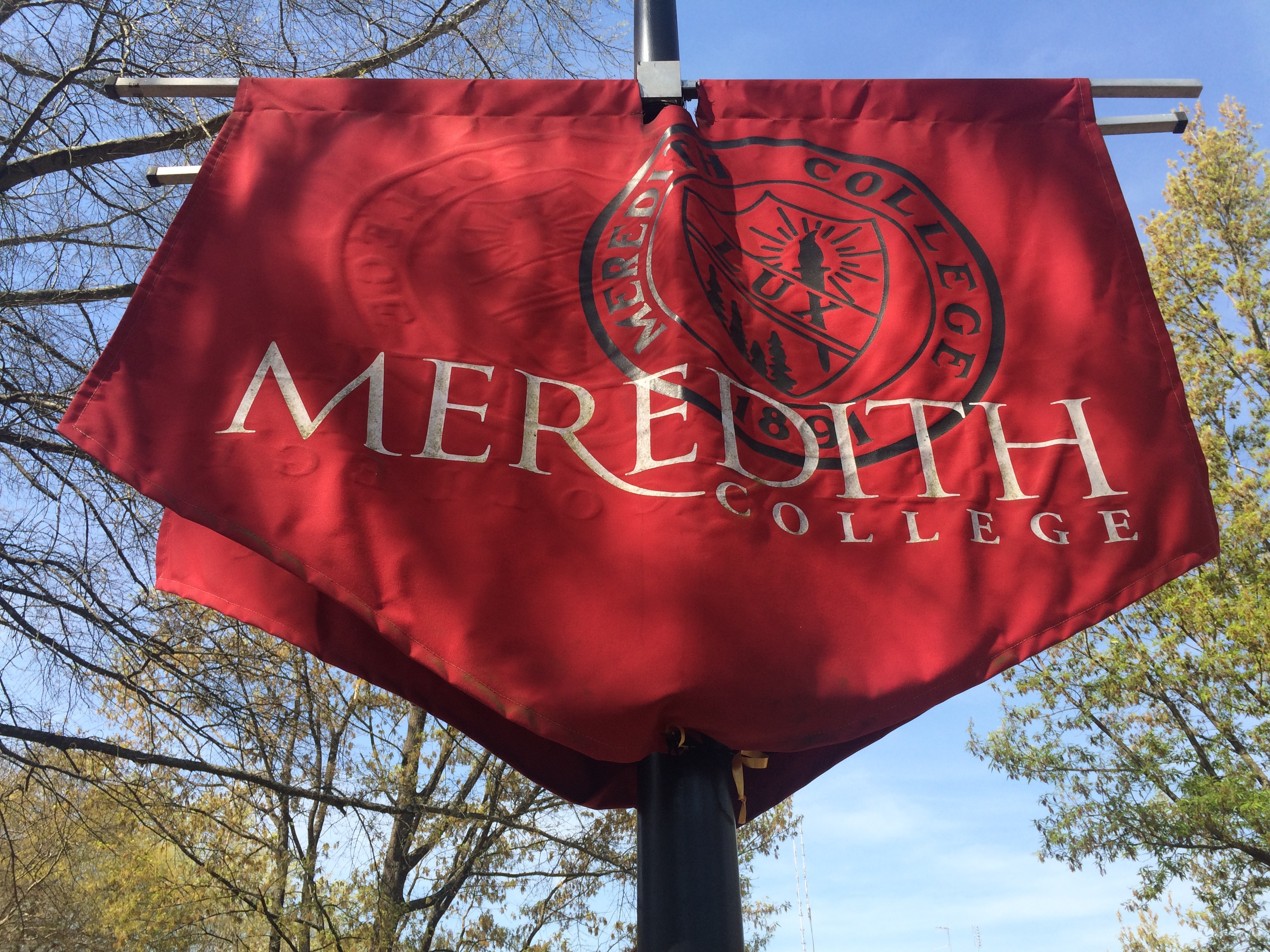 Displaying Meredith's colors and seal, these flags are located across the campus.