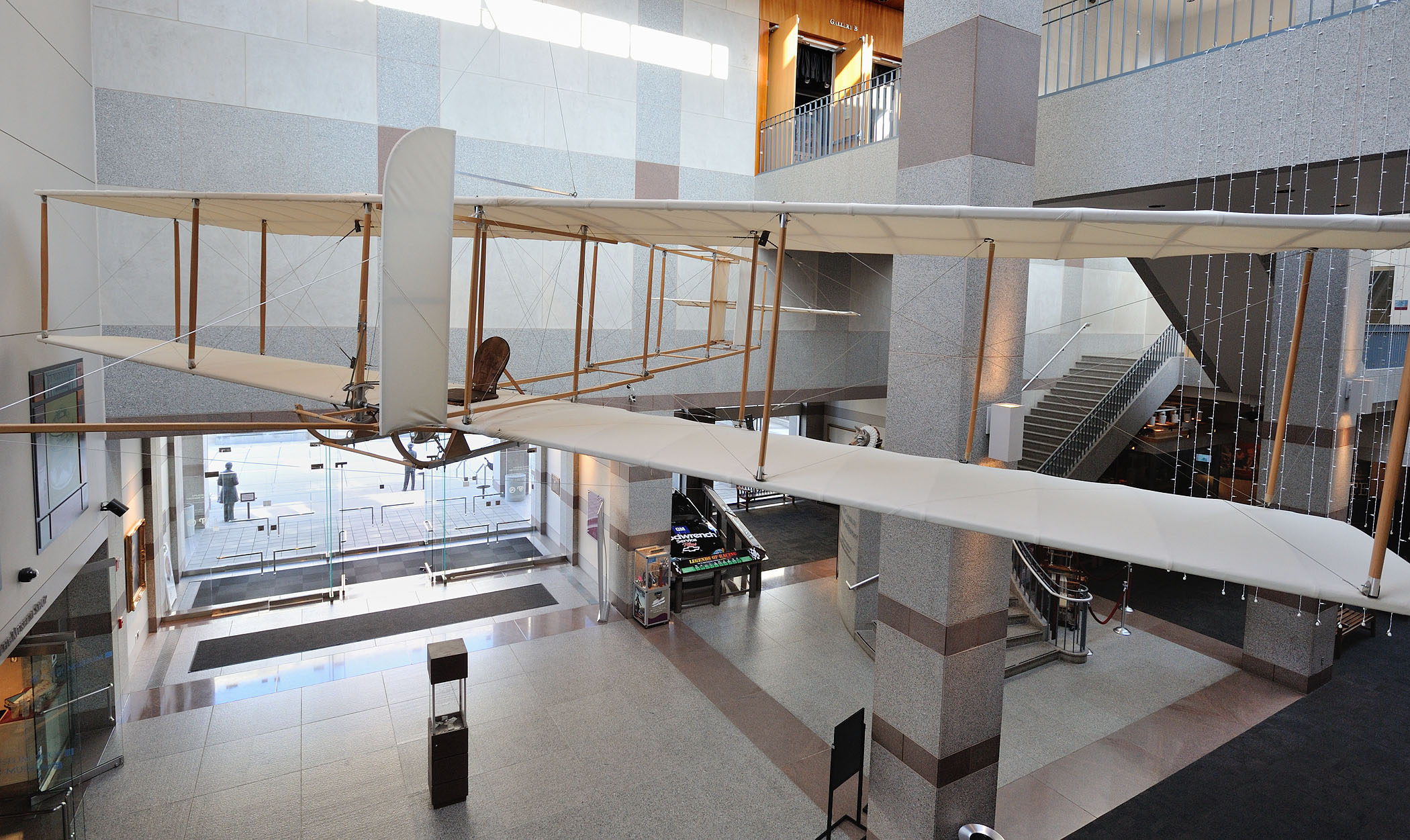 Visitors are welcomed to the museum by this replica of the Wright Brother's Glider, along with other exhibits in the museum lobby.