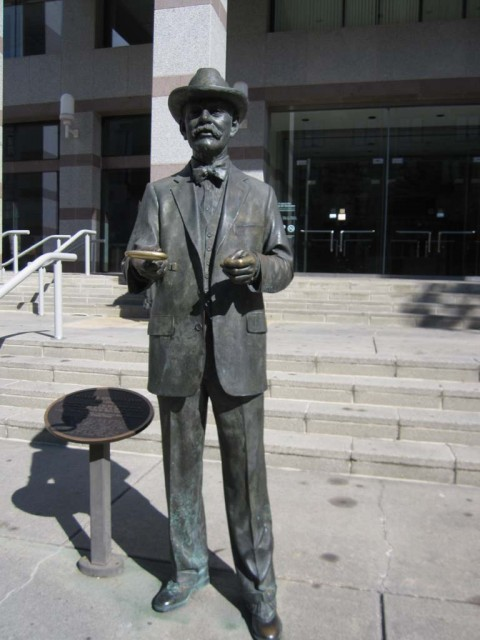 This statue of historian and editor Frederick Olds greets visitors in front of the museum he helped create.