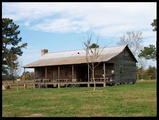 The restored 1830s dogtrot house