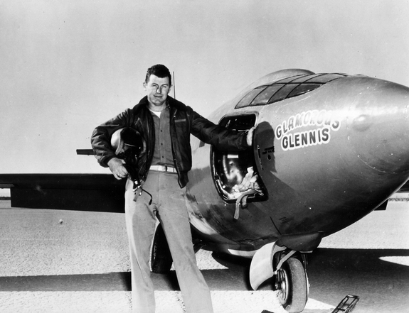 Chuck Yeager standing in front of Glamorous Glennis.-- 