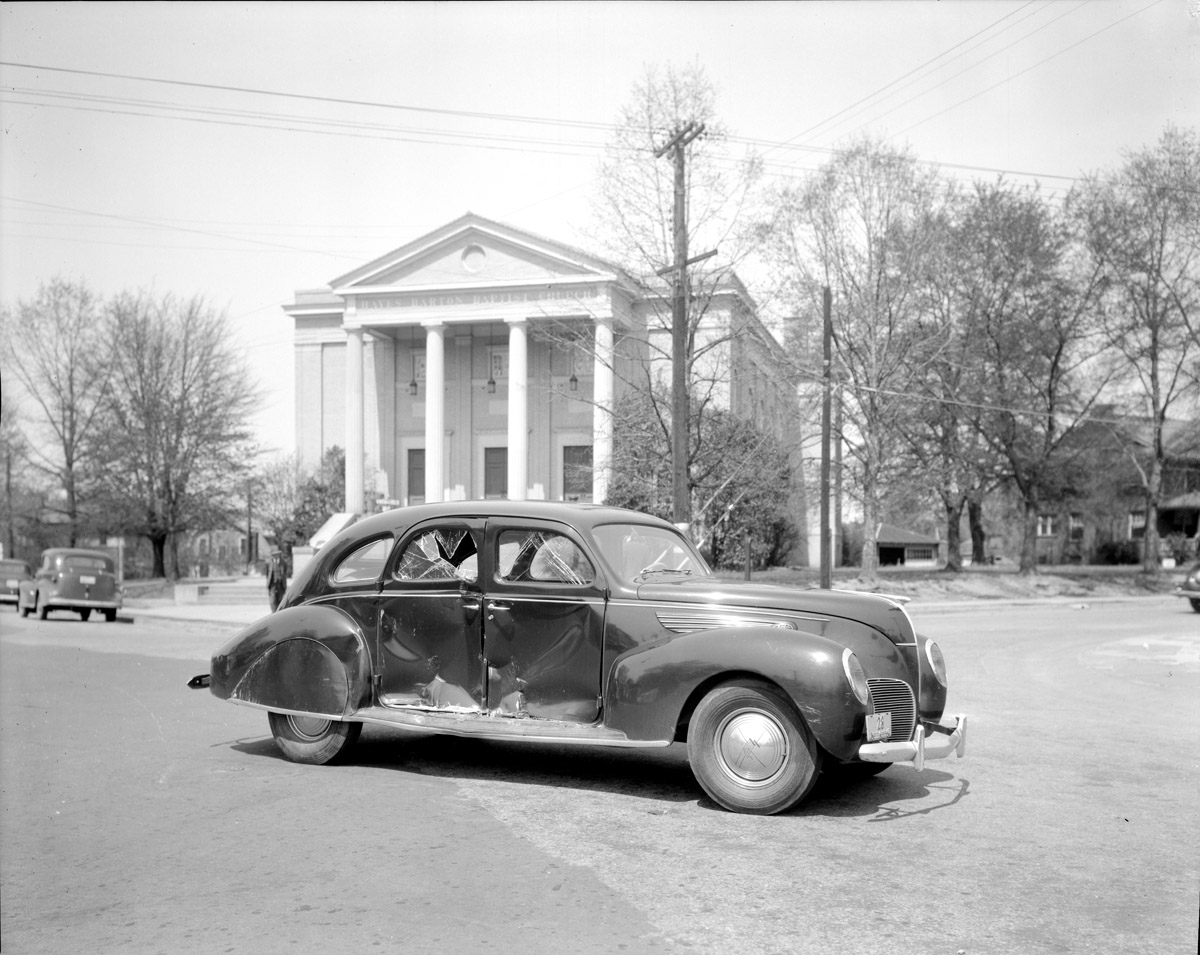 Wrecked car in front of Hayes Barton Baptist Church in Five Points   photo from: Special Collections Section State Archives of North Carolina Department of Natural and Cultural Resources