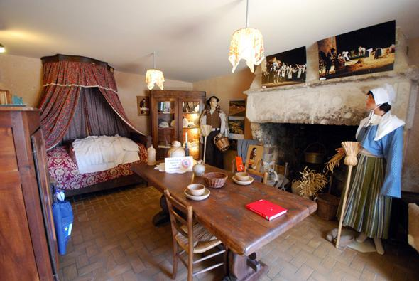 Display of a typical Acadian room within a typical Acadian home.