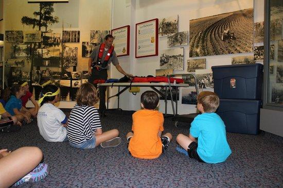Children enjoy an educational program.