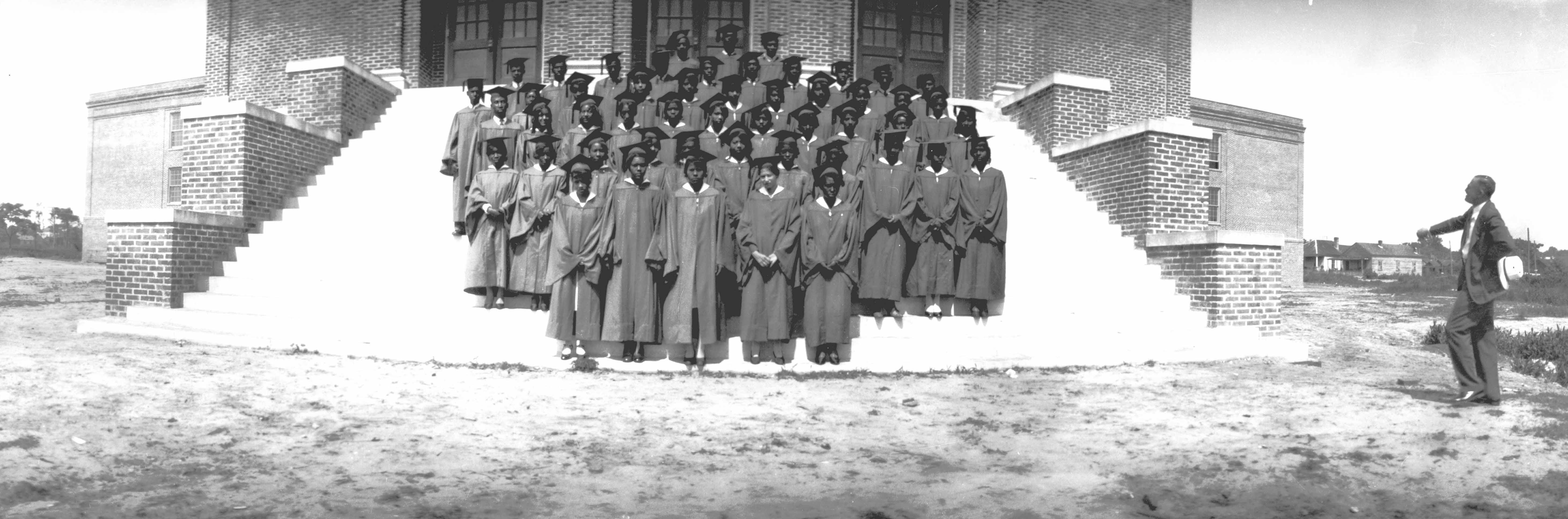 Members of the Williston High School Class of 1931 pose on the steps of a new building: the third Williston High School structure.