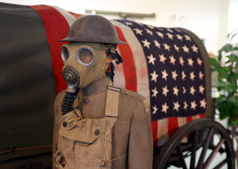 World War I gas mask and uniform on display.