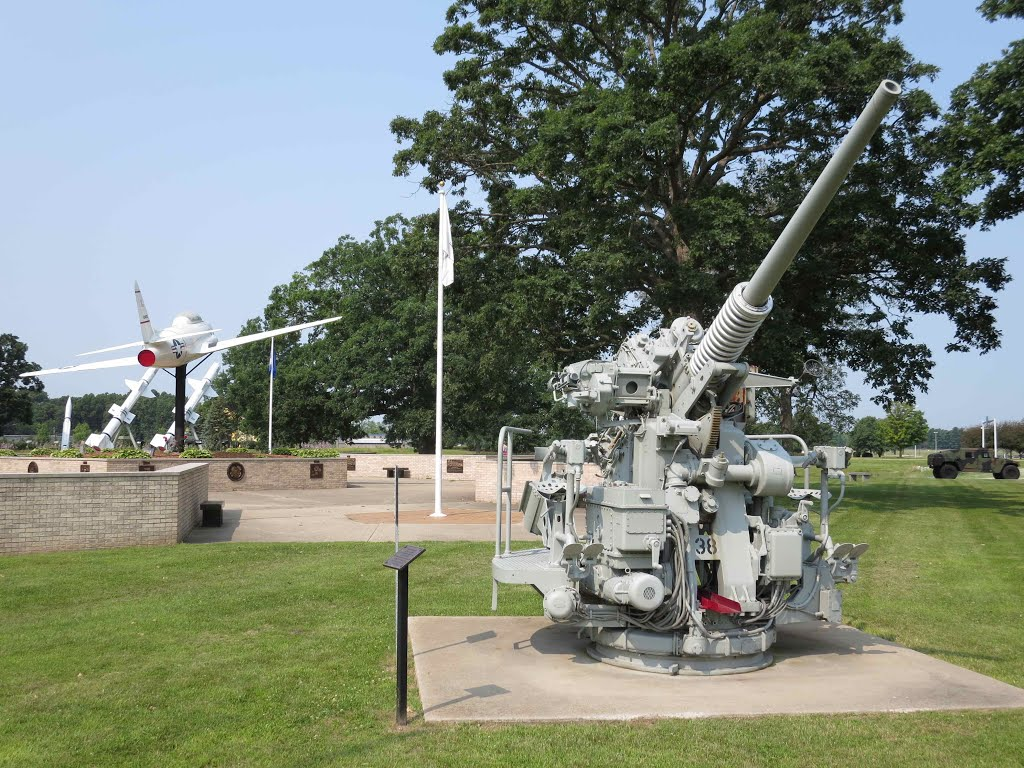 Artillery piece and aircraft located in the honor park.