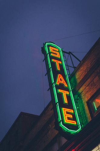 State Theatre sign illuminated at night.