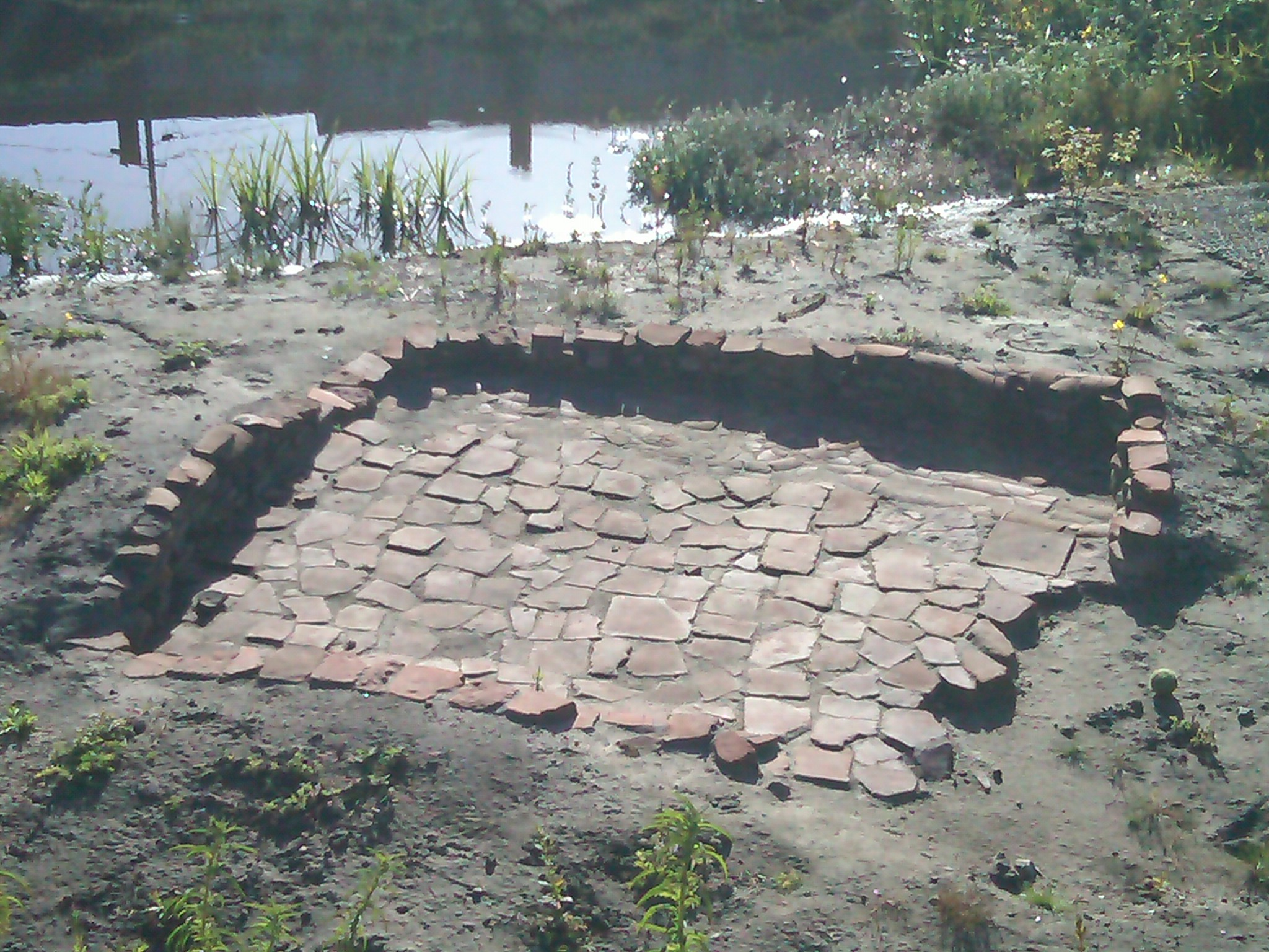Part of El Polín Spring's Colonial-era archaeological site, an excavated water storage basin from an early 19th century adobe home (image from Golden Gate Audubon Society)