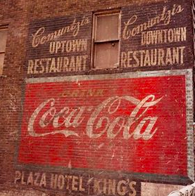 Coca-Cola mural before restoration.